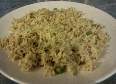 Cooked pilau rice in the pan