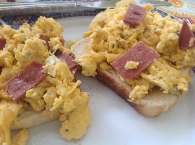 Scrambled eggs on toast with fake bacon