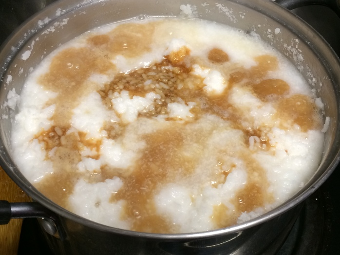 Mix coconut milk, water and rice and cook well