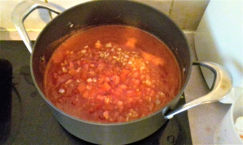 Add the diced tomatoes and onion.