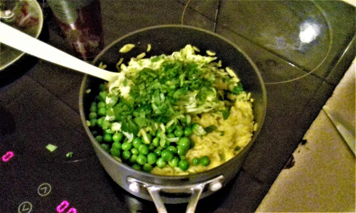 Add the peas, zucchini and parsley.