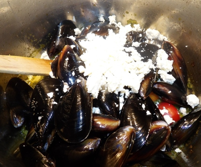 adding,all,ingredients,for,mussels