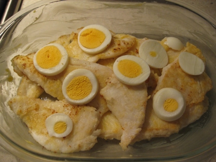 adding,boiled,egg,on,top,of,fried,fish