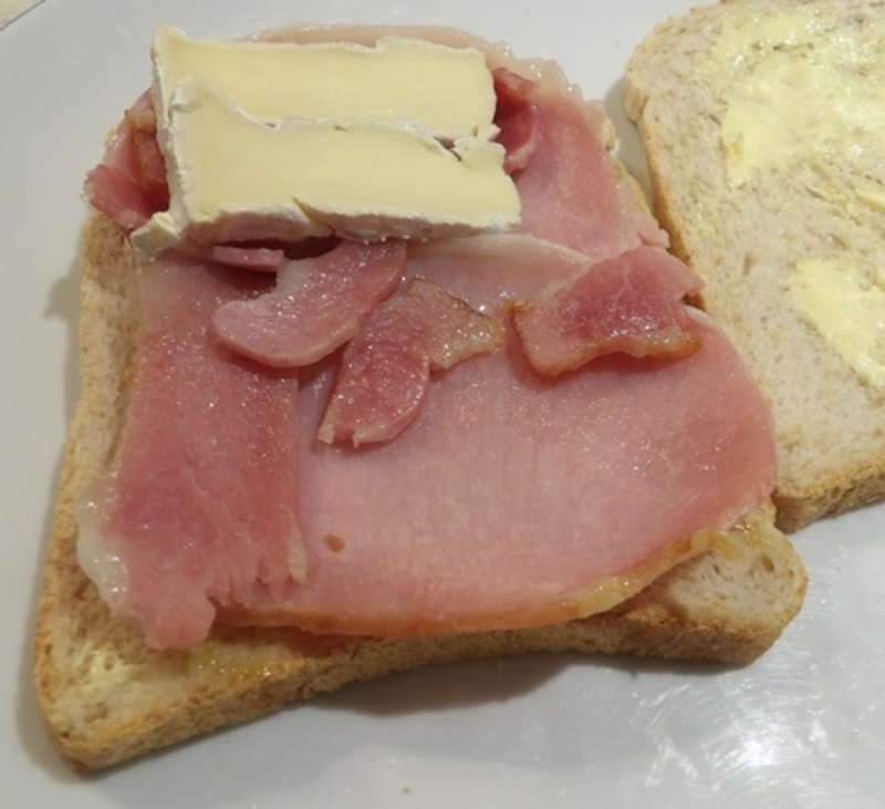 spreading,bread,with,butter,and,chutney  - Simple Lunch of Brie and Bacon Sandwiches