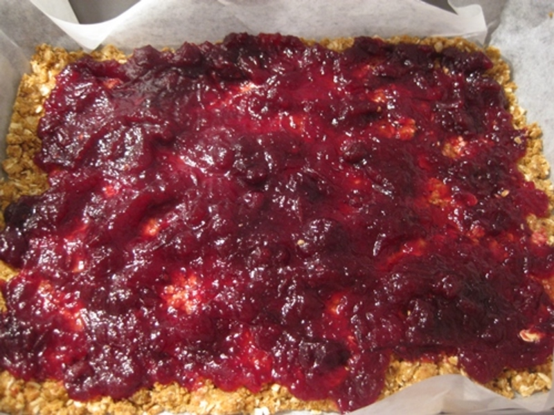 mixing,dough,for,cranberry,anzac,biscuits  - Anzac Biscuits Filled With Cranberry Sauce
