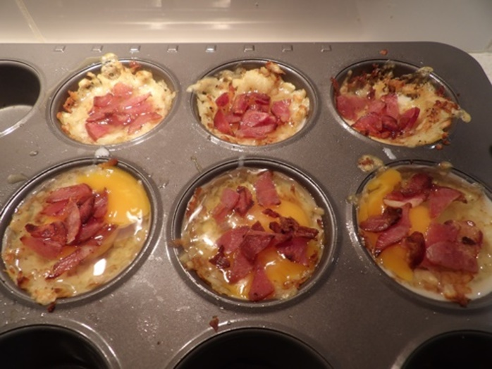 adding,egg,bacon,into,hash,brown,nests
