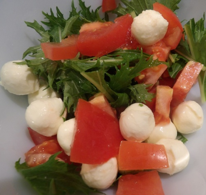 adding,mizuna,to,bocconcini,and,tomato,salad
