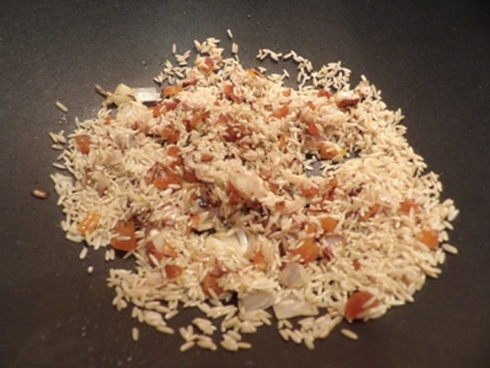 adding,rice,to,shallots,and,apricots