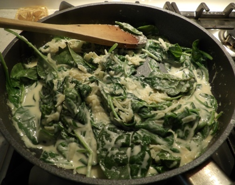 adding,egg,yolks,to,mashed,potato  - Potato Dumplings with Creamy Spinach and Parmesan Sauce