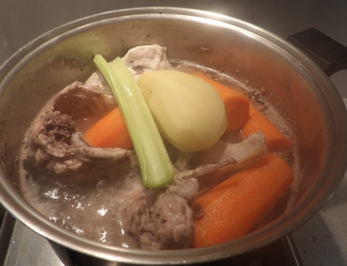 adding,vegetables,to,chicken,stock