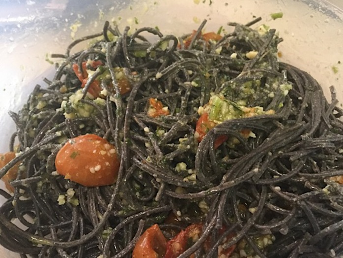 Black bean spaghetti, pesto, tomatoes