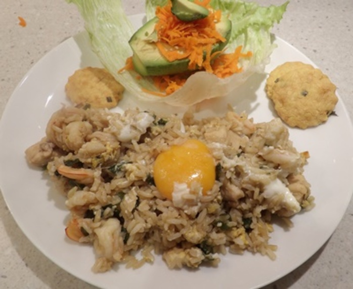 chicken,nasi,goreng,plated,with,salad,and,biscuits