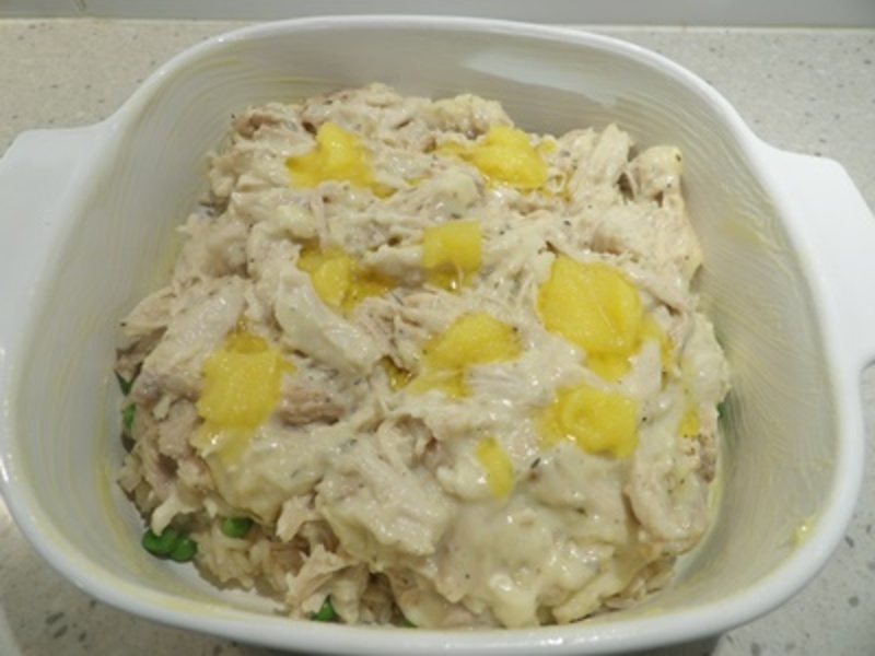 making,white,sauce,for,chicken,rice  - Chicken and Rice Casserole