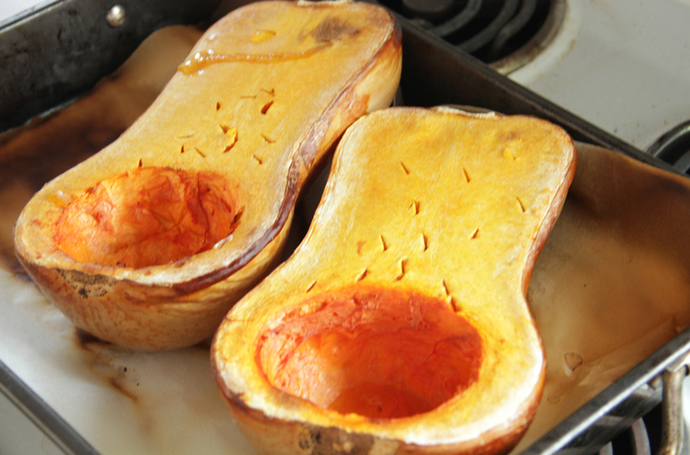 Stuffed and roasted butternut pumpkin, healthy vegetarian dinner