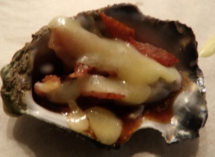 putting,sauce,on,oysters