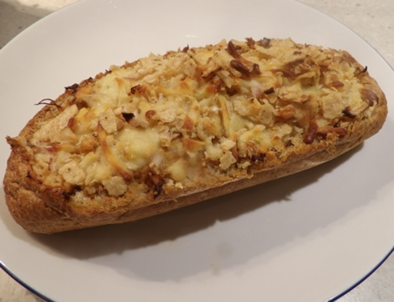 hollowing,out,bread,from,bread,roll  - Cooked Australian Sardines with Baked Bread Roll stuffed with Chicken and Salsa