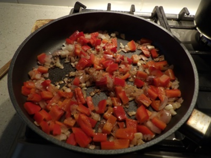 cooking,capsicum,and,onions,for,frittata