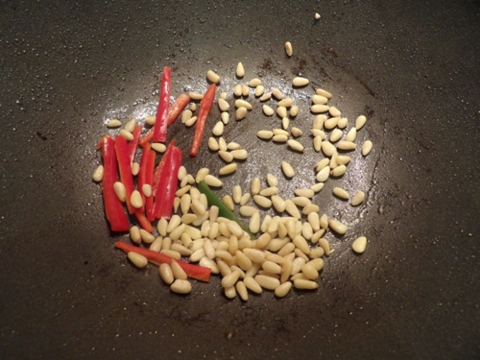 cutting,red,and,green,capsicum,for,chili,chicken