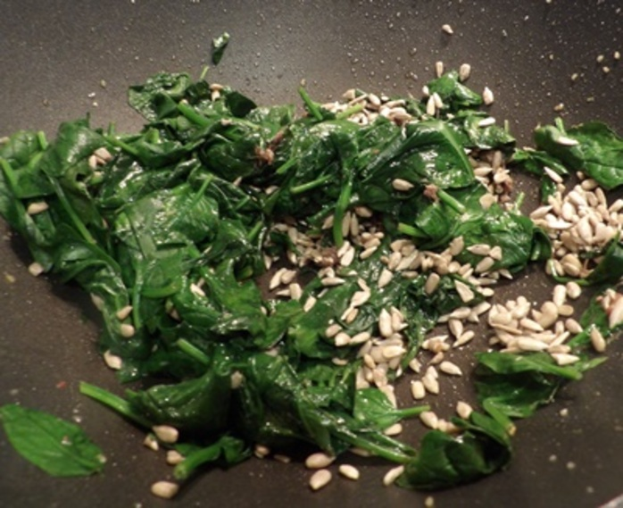 cooking,sunflower,seeds,with,spinach