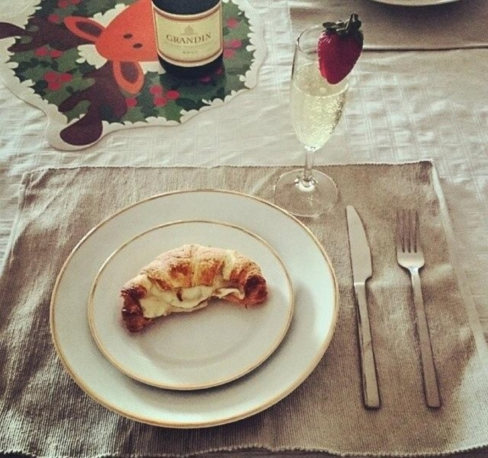 Croissant with champagne in background