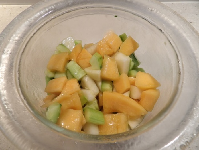 cubing,all,ingredients,and,mixing,rockmelon,pears,cucumber