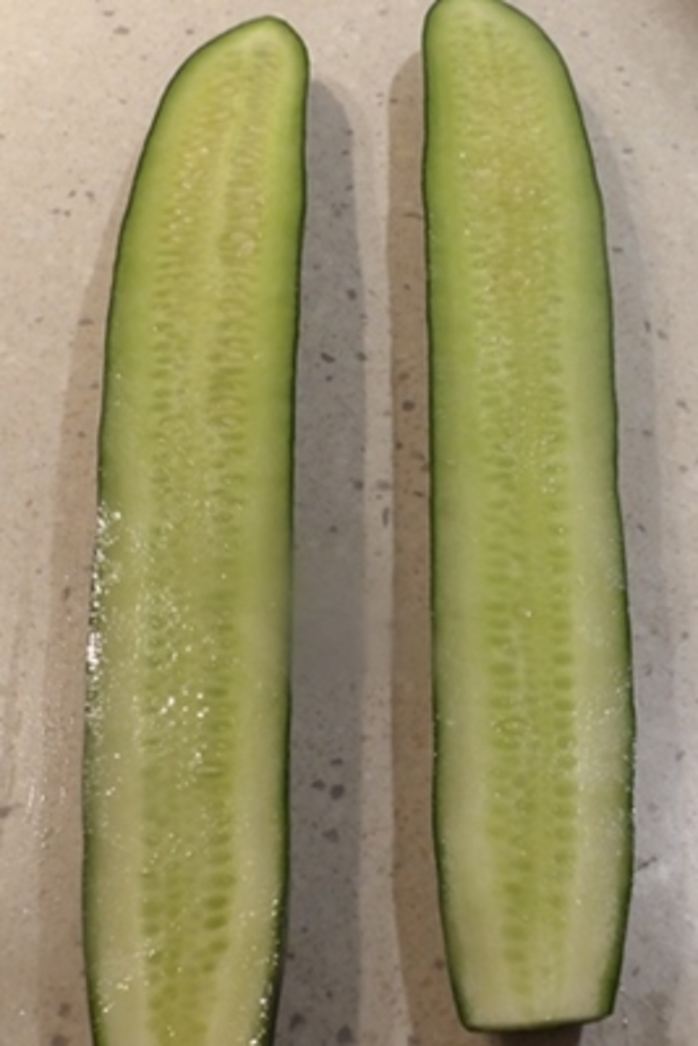 cutting,european,cucumber,in,half,lengthways