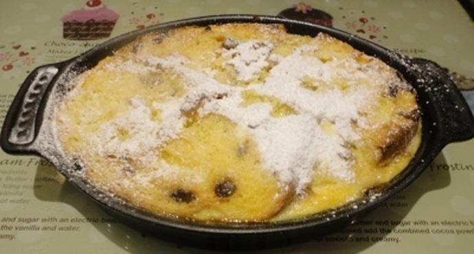 Serve the Bread and Butter Pudding with cream