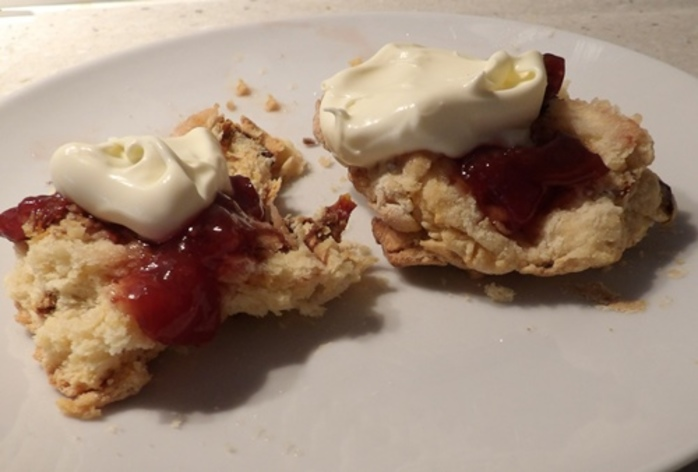 eating,damper,as,scones,with,jam,and,cream
