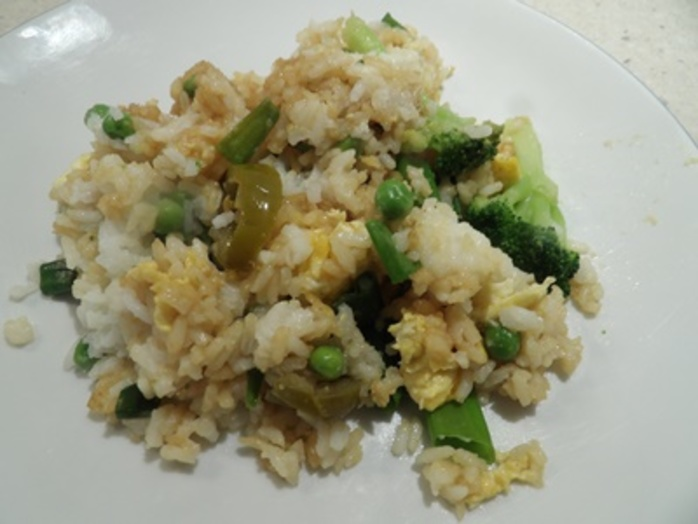 adding,vegetables,to,rice