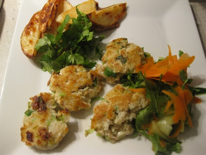 fish,cakes,with,carrot,cucumber,salad,and,chips