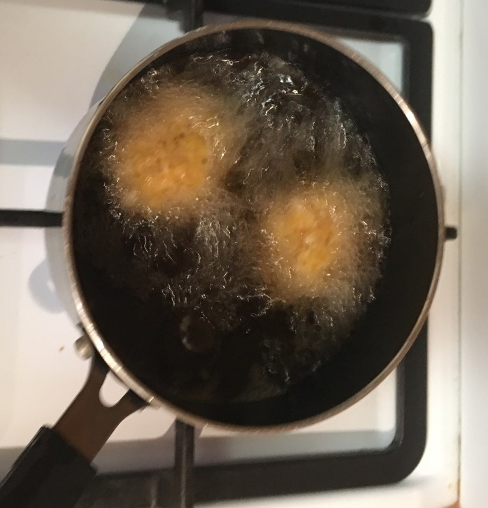 Frying the potato bites