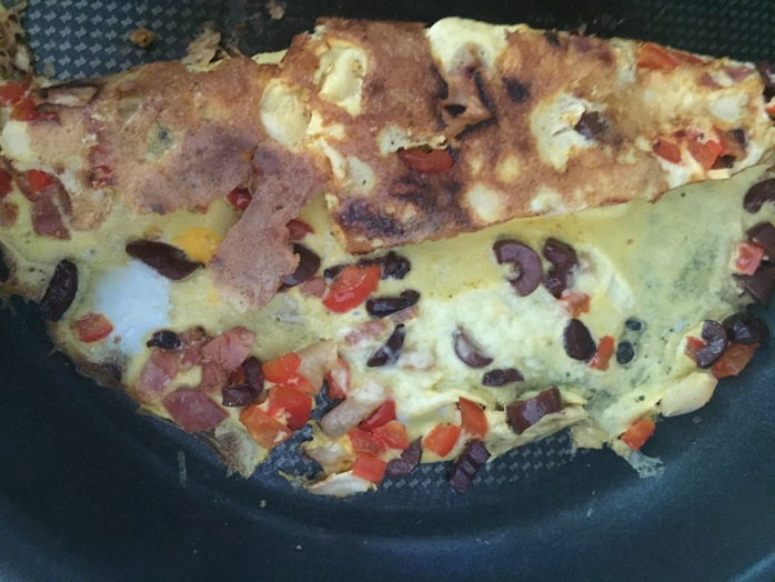 Gently roll the omelette with a spatula