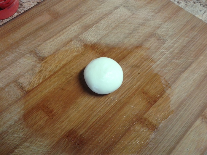 Add olive oil and knead to a soft dough ball