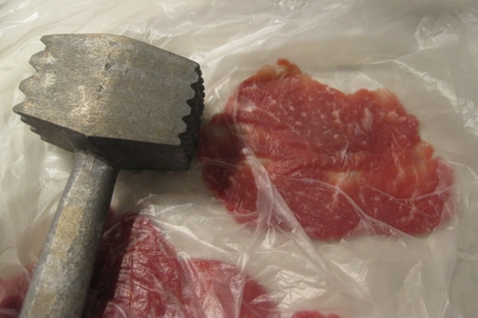 making,beef,thin,with,meat,cleaver