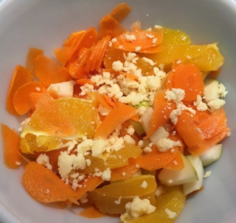 making,carrot,salad,with,pears,and,orange