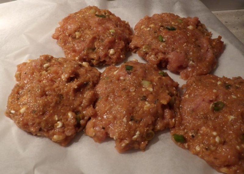 making,rissoles,from,mixed,thai,chicken,mince  - Thai Chicken Burgers With Bacon And Curried Apple Mayonnnaise
