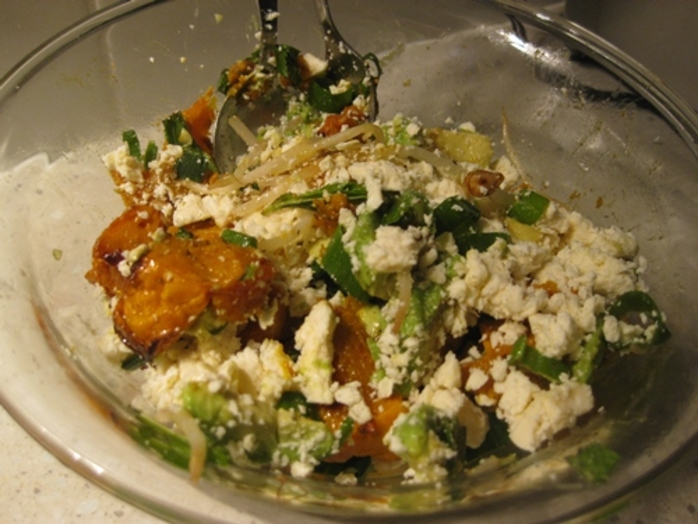 mixing,all,ingredients,for,pumpkin,and,feta,salad