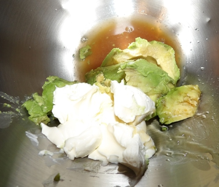 mixing,ingredients,for,avocado,dessert