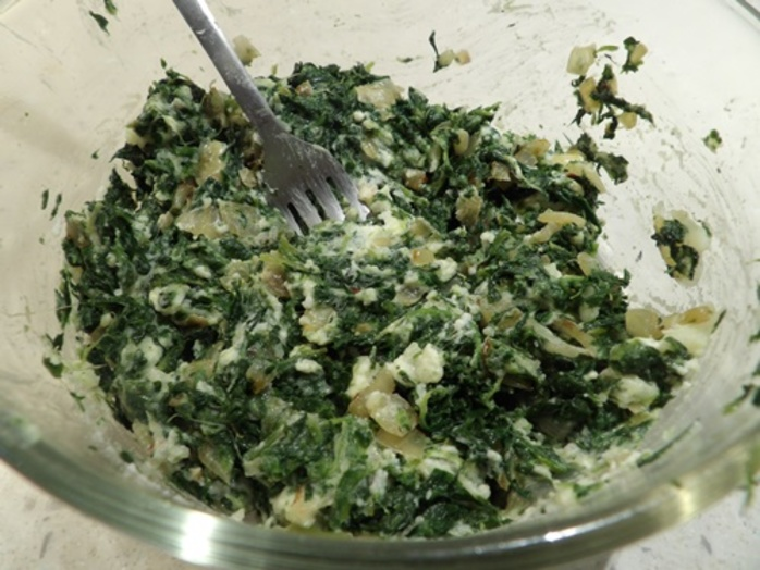 cooking,spinach,with,onions,for,spanakopita