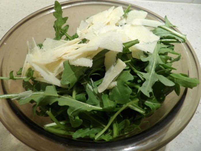 mixing,rocket,with,Parmesan,for,salad