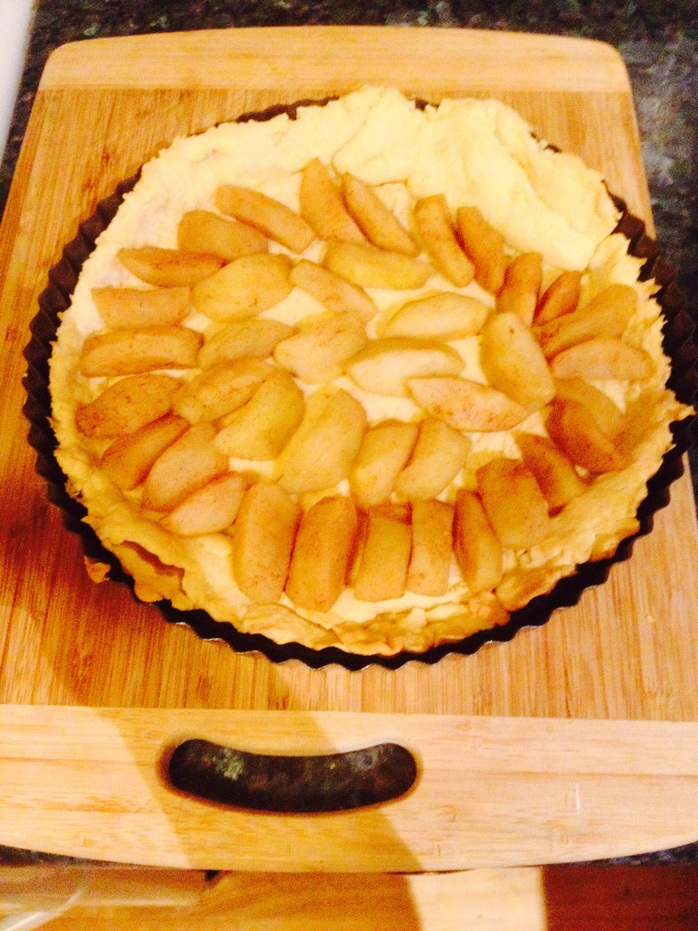 Pastry covered with apples