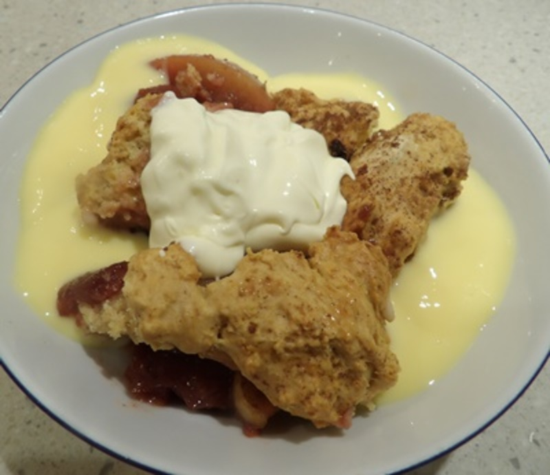 putting,stewed,apples,and,plums,in,ovenproof,dish
