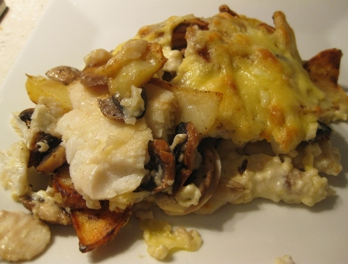 plated,baked,fish,with,mushrooms,chips,and,sour,cream,sauce