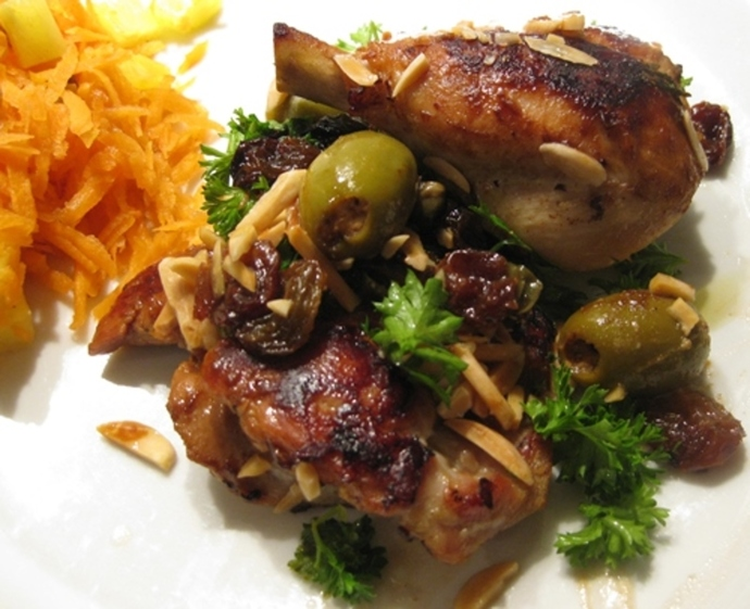 plated,chicken,legs,olives,almonds,sultanas