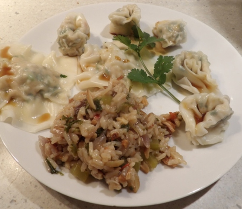 plated,chicken,ravioli,with,rice,and,slivered,almonds