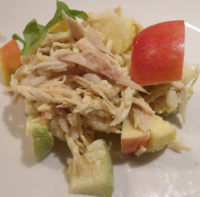 mixing,pulled,chicken,and,red,and,green,apples