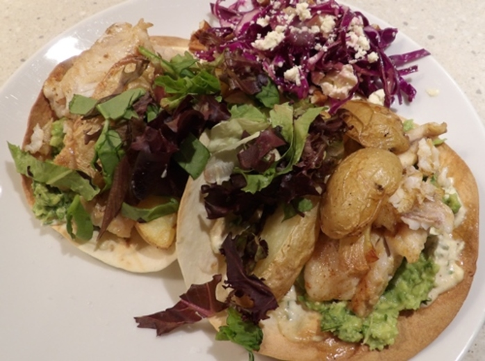 plated,fish,and,chip,tacos,with,salad,and,lettuce