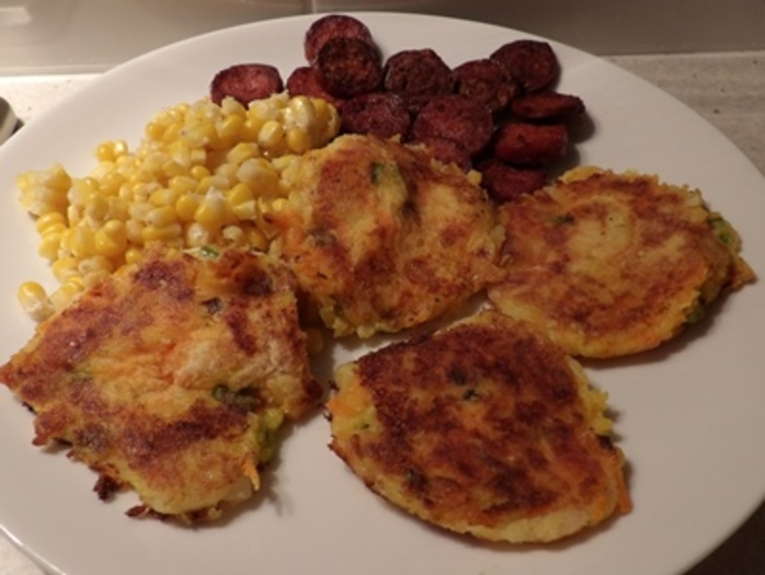 plated,mashed,mini,potato,pancakes,with,chorizo,and,sweet,corn