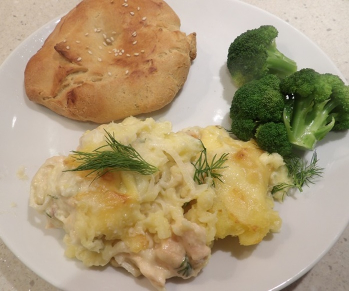 plated,meal,salmon,dill,pie,with,naan,bread,and,broccoli