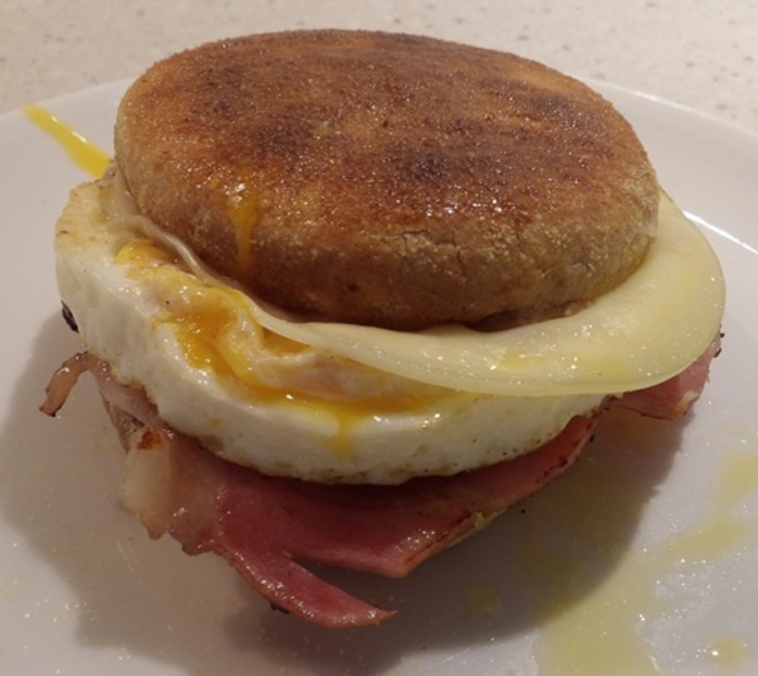 plated,muffin,with,bacon,egg,and,cheese